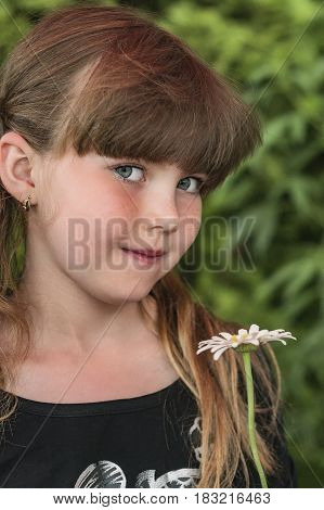 Portrait of young girl with pigtails in summer