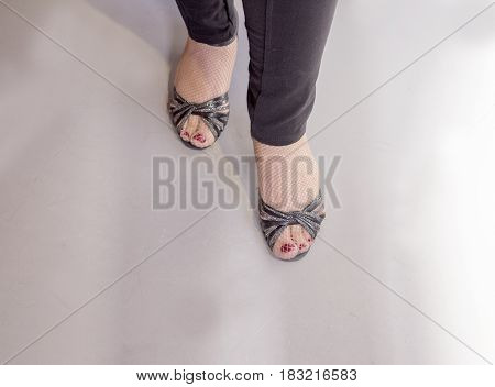 Woman dancing with black salsa sandals. View above