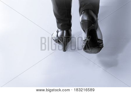 Woman dancing with black salsa sandals. Isolated