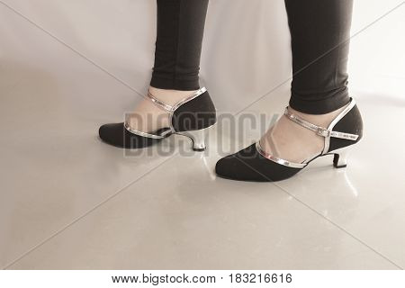 Woman dancing with black and silver salsa shoes