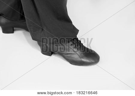 Man dancing with black salsa shoes. Isolated