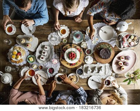 Friends Gathering Together on Tea Party Eating Cakes Enjoyment happiness