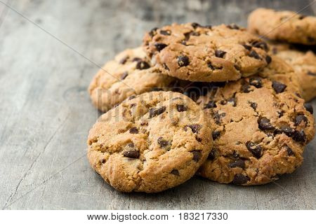 Chocolate chip cookies on wooden table background