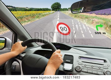 smart car concept - driving at country road with head up system shows road informaion