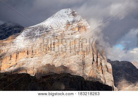 Evening view of Gruppo di Tofana or Le Tofane Grupe with clouds alps dolomites mountains Italy