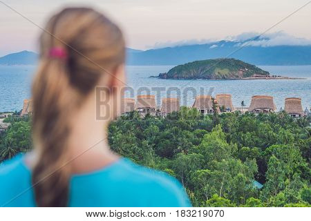 A Young Woman Looks At The Sea. Focus On The Sea