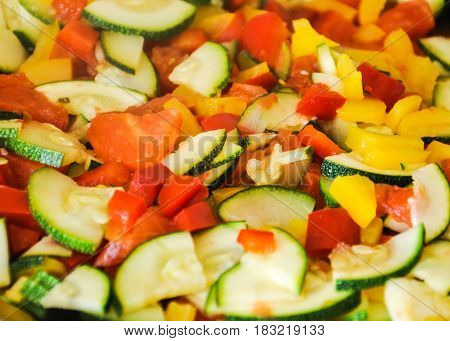 A health bomb of vegetables frying on a pan.