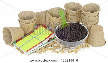 a bunch of pitchers cups of peat earth humus in a glass bowl a green plastic scoop Packed in bags seeds garden plant nasturtiums pumpkin and zucchini seedlings to plant isolated on white background