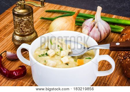 Vegetable cream soup with croutons. Studio Photo