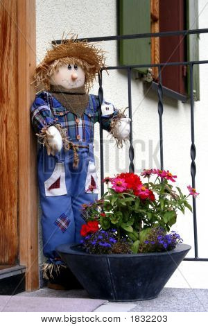 Cute Scarecrow Outside A House