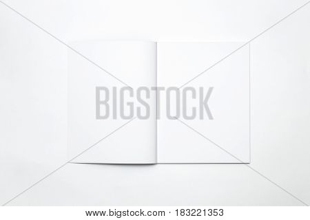 Blank open magazine on white background for business ideas