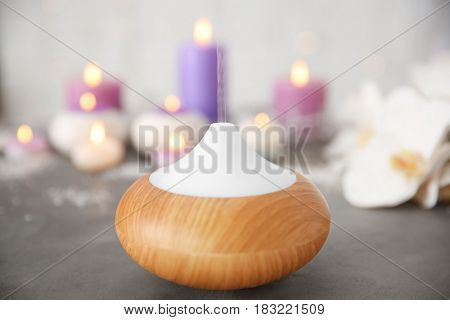 Oil diffuser on blurred background