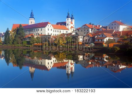 Morning view of Telc or Teltsch town mirroring in lake World heritage site by unesco in Czech Republic