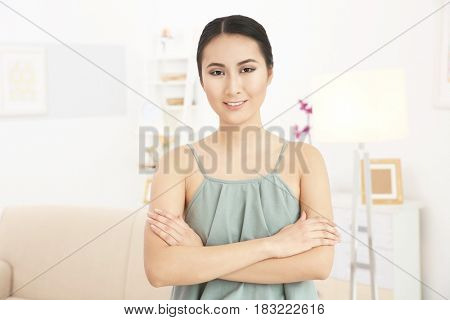 Portrait of beautiful Asian woman resting at home