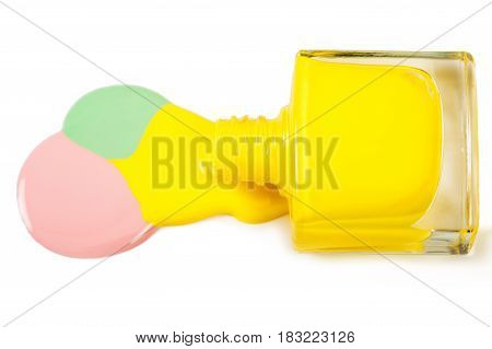 Yellow nail polish spilled isolated on the white background