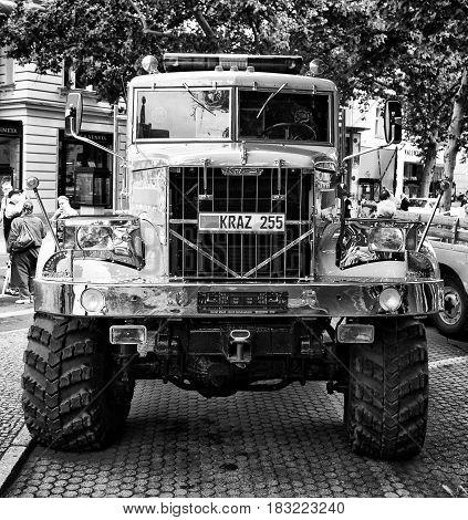 "BERLIN - MAY 28: Soviet heavy truck KrAZ-255 (Black and White) the exhibition ""125 car history - 125 years of history Kurfurstendamm"" May 28 2011 in Berlin Germany"