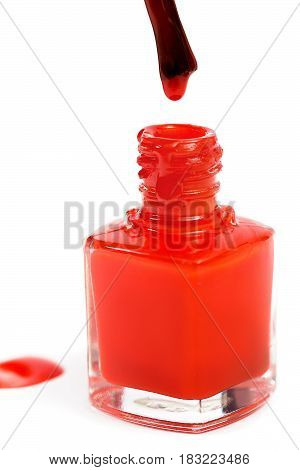 red nail Polish and brush isolated on the white background