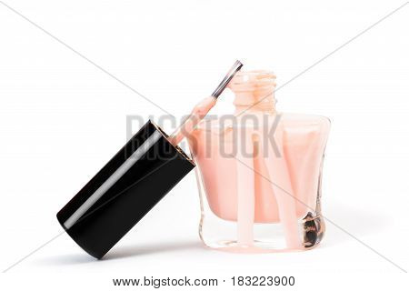 pink nail Polish spilled isolated on the white background