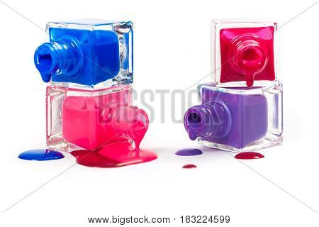 Stack of pink and blue nail polish isolated on the white background