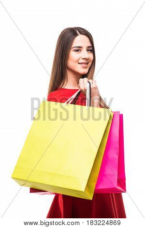 Beautiful Young Woman With Color Shoping Bags In Hands On White Background