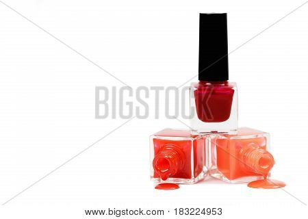 Stack of red nail polish isolated on the white background