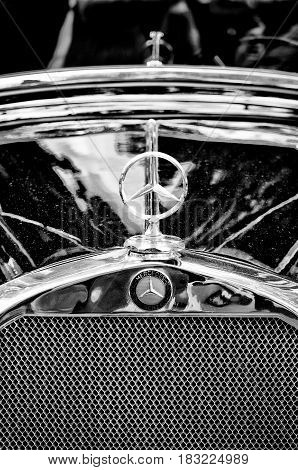 "BERLIN - MAY 28: Mercedes-Benz symbol on the hood (Black and White) the exhibition ""125 car history - 125 years of history Kurfurstendamm"" May 28 2011 in Berlin Germany"