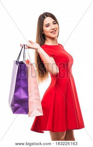 Beautiful Woman With Color Shoping Bags In Hands On White Background