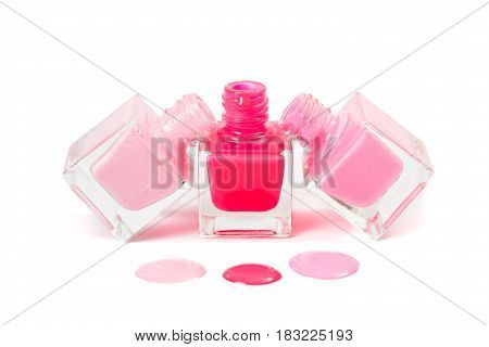 Stack of pink nail polish isolated on the white background
