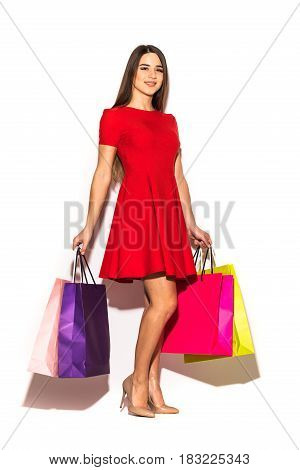 Full Height Woman With Color Shoping Bags In Hands On White Background