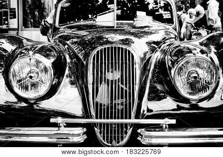 """BERLIN - MAY 28: Car Jaguar XK 120 DHC close-up fragment (black and white) the exhibition """"125 car history - 125 years of history Kurfurstendamm"""" May 28 2011 in Berlin Germany"""