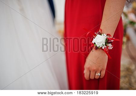 Hands Of Bridesmaids At Red Dresses With Wedding Bouquet At Church.
