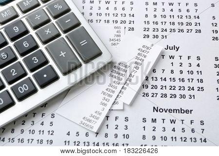 Calculator on calendar. Tax concept