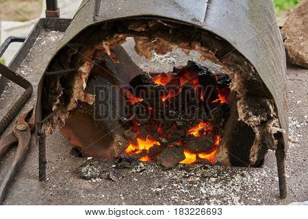 A handmade oven for heating metal blanks in the smithy