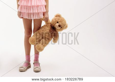 Best life period. Small girl holding soft toy. Isolated. Copy space on right side. Close up