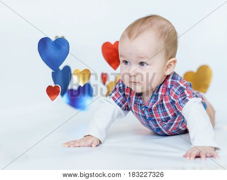 Beautiful baby is smiling. background as a heart