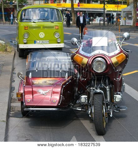 "BERLIN - MAY 28: Motorcycle Honda Gold Wing GL1100 and minibus Volkswagen Type 2 the exhibition ""125 car history - 125 years of history Kurfurstendamm"" May 28 2011 in Berlin Germany"