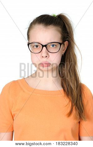 Portrait Of A Teenage Girl With An Offended Grimace On Her Face.