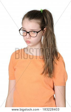 Portrait Of A Pretty Teenage Girl With An Offended Grimace On Her Face On A Clean White Background.