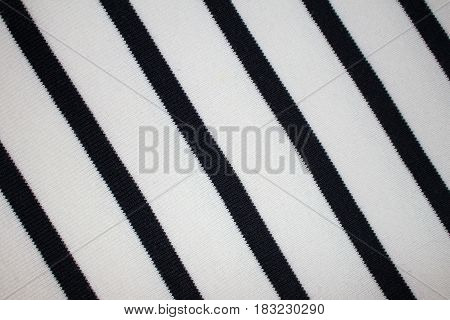 the texture of the knitted fabric with striped pattern , black and white