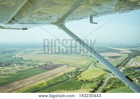 View to the rural lanscape from the board of a light plane