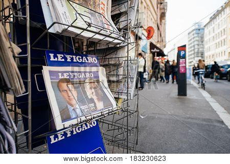 PARIS FRANCE - APRIL 24: press kiosk at French newspaper Le Figaro with pictures of French Presidential election candidates Emmanuel Macron Marine Le Pen a day after first round of French Presidential election on April 23 2017