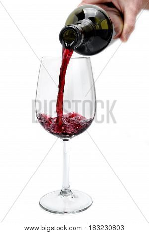 Red Wine Poured From A Bottle In A Elegant Crystal Goblet, Isolated On White Background.
