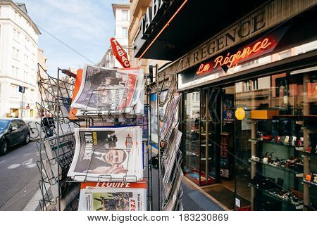 PARIS FRANCE - APRIL 24: press kiosk at French newspaper with pictures of French Presidential election candidates Emmanuel Macron Marine Le Pen a day after first round of French Presidential election on April 23 2017