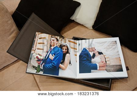 Open Pages Of Brown Luxury Leather Wedding Book Or Album.