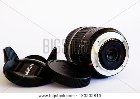 Orebro, Sweden - April 21, 2017: Tamron 18-270 Di Ii Lens For Sony A-mount With Hood And Caps On Whi