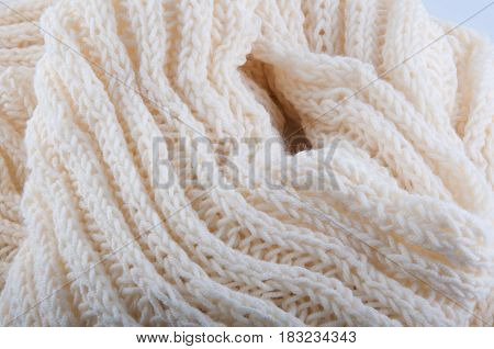 Creamy off-white wool knitwork full frame for warming backdrop or background