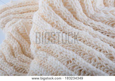 Fragment of creamy handmade wool knitwork. Background