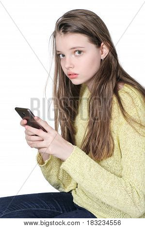Young Girl With Mobile Phone In Hands..