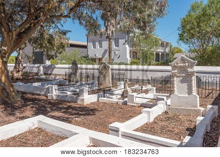 LADISMITH SOUTH AFRICA - MARCH 25 2017: Historic graves at the old Dutch Reformed Church in Ladismith.The church was completed in 1874 and is now a museum