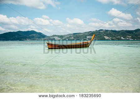 Boat in the Andaman sea shore in Thailand. Vacation, travel, holidays